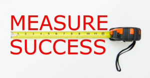 Image of tape measure and words 'measuring success'