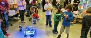 Children in a class exploring how to program a robot