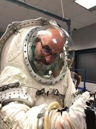 Scott McCallum tries on space suite