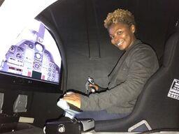 ED Joy Harris takes the helm of a spacecraft simulator