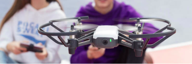 children in background flying a Tello drone